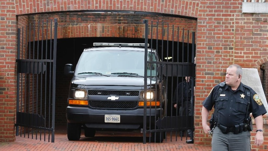 March 4, 2015: Sheriff's deputies guard a van carrying Jesse Matthew Jr. after a hearing at the Albemarle County Circuit Court in Charlottesville, Va. (AP)