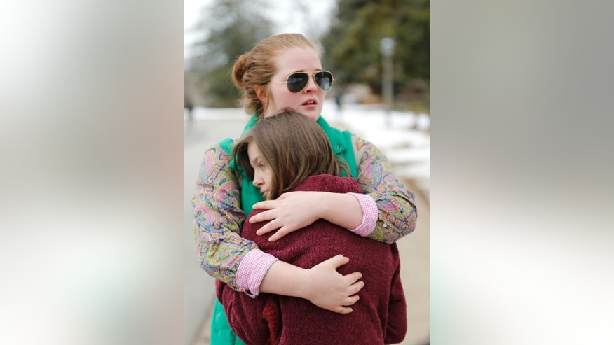 Anna ten Bensel, (cq) with glasses, comforts fellow sophomore Lauren Jacobson Tuesday, March 3, 2015, after hearing the news that Sweet Briar College will close at the end of the school year. The president announced the closing in Babcock Auditorium. (AP Photo/Richmond Times-Dispatch, Alexa Welch Edlund)
