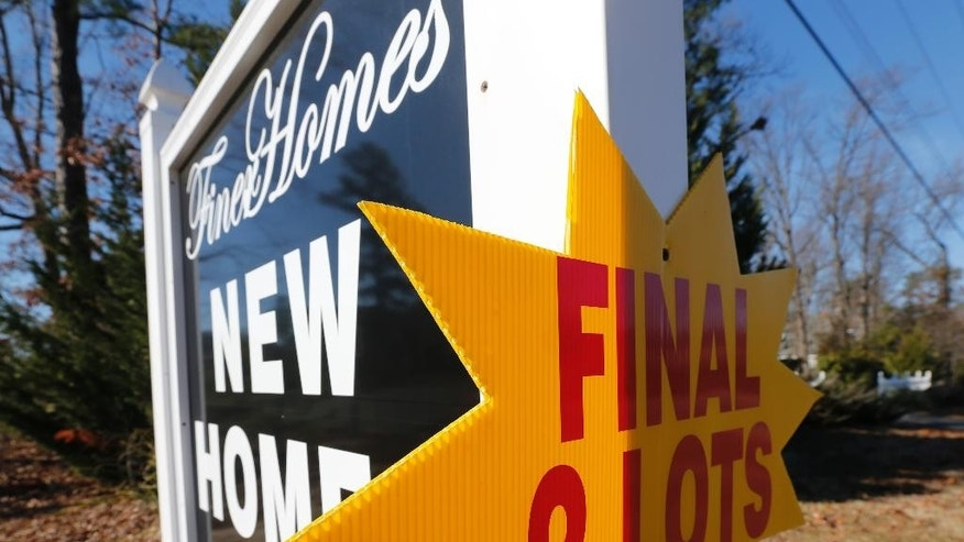 This Jan. 8, 2015 photo shows a sign advertising lots for new homes for sale in Richmond, Va. Freddie Mac, the mortgage company, releases weekly mortgage rates on Thursday, March 5, 2015. (AP Photo/Steve Helber)