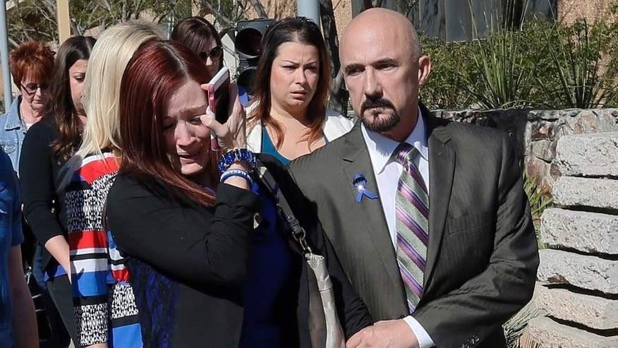 Tanisha Sorenson, sister of murder victim Travis Alexander, cries as she leaves the courthouse with family and friends, Thursday, March 5, 2015, in Phoenix. A judge declared a mistrial Thursday in the Jodi Arias sentencing retrial after a jury deadlocked on whether the convicted murderer should be executed or sent to prison for life for the 2008 killing of Travis Alexander. (AP Photo/Matt York)