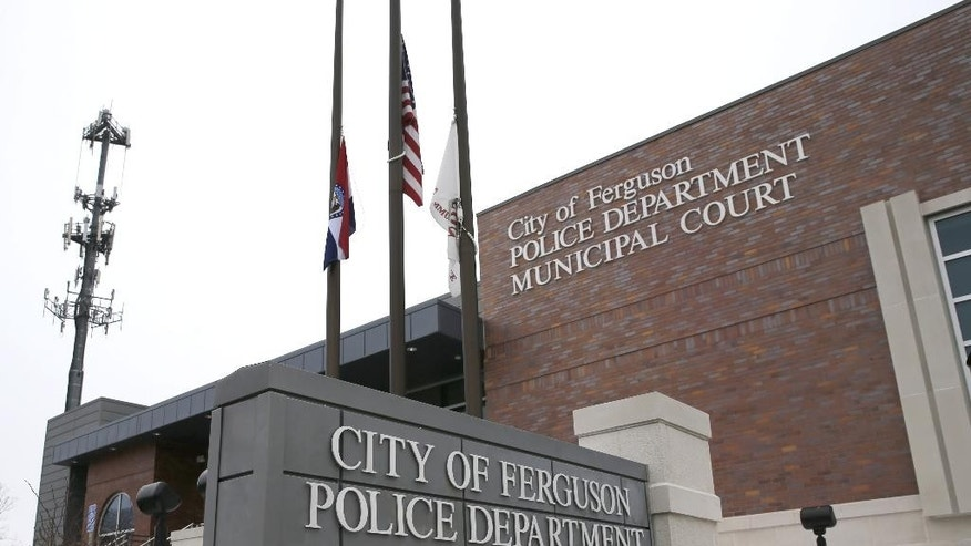 This photo taken Wednesday, March 4, 2015, shows the entrance to the Ferguson, Mo., Police Department. The Justice Department cleared a former Ferguson, Mo., police officer in the fatal shooting of an unarmed black 18-year-old, but also issued a scathing report calling for sweeping changes in city law-enforcement practices it called discriminatory and unconstitutional. (AP Photo/Charles Rex Arbogast)