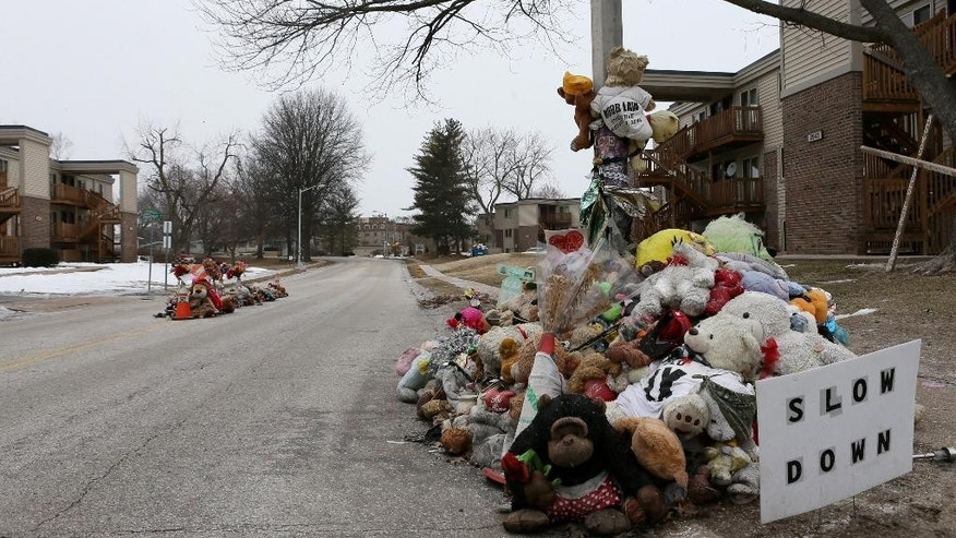 Memorials to Michael Brown at Canfield Green Apartments, in Ferguson, Mo., are maintained on Wednesday, March 4, 2015, more than six months after being shot to death by Ferguson police officer Darren Wilson on Aug. 9, 2014. The U.S. Justice Department will not prosecute Wilson, a white former police officer in the fatal shooting of Brown, an unarmed black 18-year-old whose death in Ferguson, sparked weeks of protests and ignited an intense national debate over how police treat African-Americans. But the government released a scathing report Wednesday that faulted the city for racial bias. (AP Photo/St. Louis Post-Dispatch, David Carson )  EDWARDSVILLE INTELLIGENCER OUT; THE ALTON TELEGRAPH OUT; MANDATORY CREDIT   MBI  (REV-SHARE)