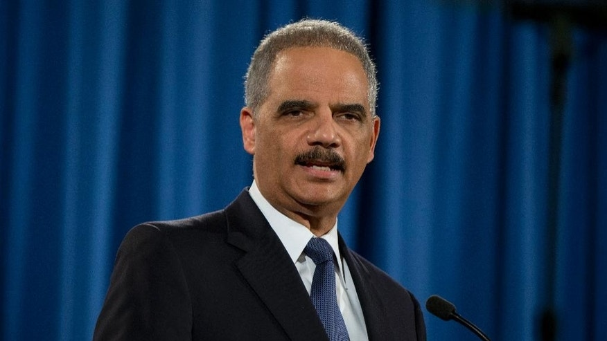 Attorney General Eric Holder speaks at the Justice Department in Washington, Wednesday, March 4, 2015, about the Justice Department's findings related to two investigations in Ferguson, Mo. The Justice Department will not prosecute a white former police officer in the fatal shooting of an unarmed black 18-year-old whose death in Ferguson sparked weeks of protests and ignited an intense national debate over how police treat African-Americans. But the government released a scathing report Wednesday that faulted the city for racial bias. (AP Photo/Carolyn Kaster)