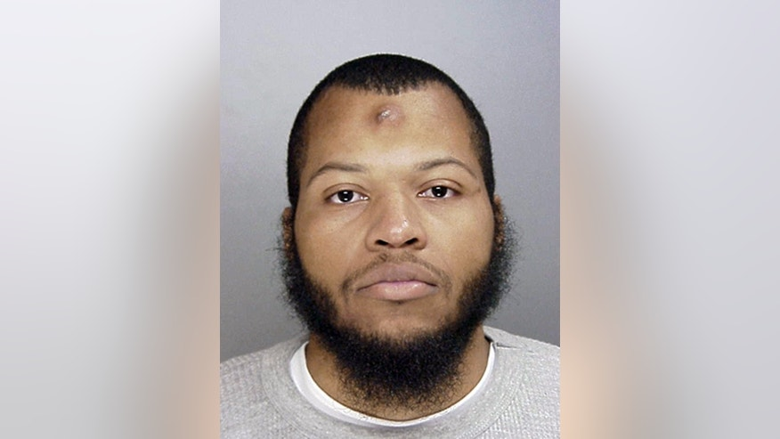This undated photo provided by the Philadelphia Police Department shows Carlton Hipps. Police identified Hipps and his brother, Ramone Williams, on Friday, March 6, 2015, as suspects arrested for the murder of Police Officer Robert Wilson III during a gunfight in a robbery attempt on Thursday, March 5, 2015 in Philadelphia. (AP Photo/Philadelphia Police Department)