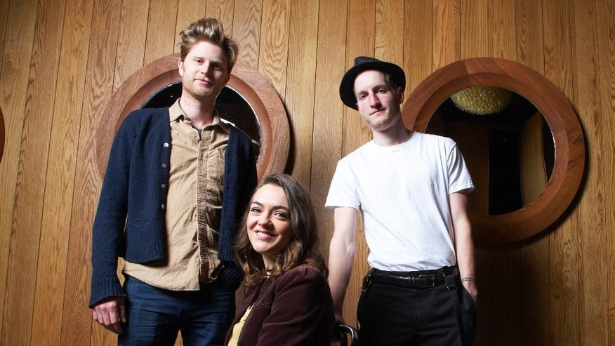 "FILE - In this Jan. 18, 2013 file photo, from left, Wesley Schutlz, Neyla Pekarek and Jeremiah Fraites of The Lumineers pose at the Dream Downtown Hotel in New York. Fraites says that a picture of a New Jersey newspaper columnist is the secret to the bands' success. He posted a picture of his keyboard with the picture of The Record political columnist Herb Jackson to the folk rock band's Facebook, Instagram and Twitter accounts on Thursday, March 6, 2015. He says that he taped the picture to his keyboard 10 years ago and that ""looking at him assures me creativity will flow.""  (Photo by Dan Hallman/Invision/AP, File)"