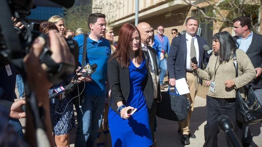 Murder victim Travis Alexander's sister Tanisha Sorenson, center, leaves the court house after the Jodi Arias sentencing retrial in Phoenix on Thursday, March 5, 2015. Arias was spared the death penalty on Thursday after a jury for a second time could not decide on her punishment. (AP Photo/The Arizona Republic, Michael Schennum) MARICOPA COUNTY OUT; MAGAZINES OUT; NO SALES