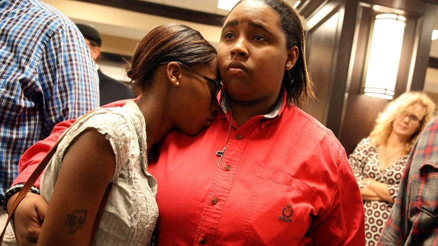 Feb. 9, 2015: Shay French, right, and Kiera Willis, both of Mobile, Ala., embrace after learning that Mobile County probate judge Don Davis refused to issue marriage licenses at the Mobile County Probate office.