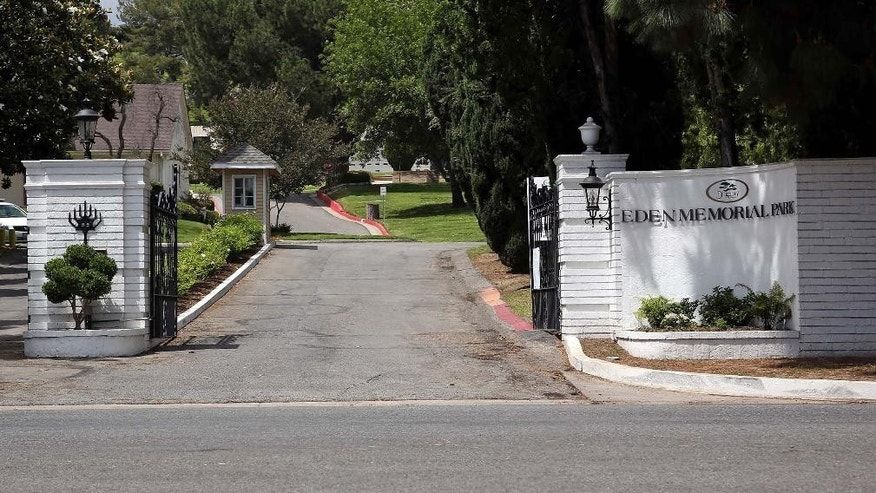 FILE - This May 19, 2014 file photo shows the entrance to Eden Memorial Park in the Mission Hills area of Los Angeles. Eden, one of the nation's largest Jewish cemeteries and the resting place of notables including Groucho Marx, has been sued for allegedly breaking vaults to make room for more graves and throwing out human bones in a pile. The lawsuit was filed in Los Angeles Superior Court in the first week of March 2015. (AP Photo/Nick Ut, File)