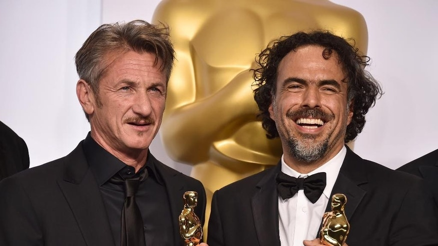 "FILE - In this Feb. 22, 2015 file photo, presenter Sean Penn, left, and filmmaker Alejandro Iñárritu pose in the press room after winning multiple awards including best original screenplay, best director and best picture for ""Birdman: Or (The Unexpected Virtue of Ignorance),"" at the Oscars in Los Angeles. On Saturday, March 7,  during a promotional tour for his new film ""The Gunman,"" in Beverly Hills, Penn opened up about the green card joke he made during the Oscars saying that he has ""absolutely no apologies"" for his comment. ""I found it hilarious,"" Iñárritu said after the ceremony. ""Sean and I have that kind of brutal (relationship) where only true friendship can survive."" Iñárritu directed Penn in the 2003 film ""21 Grams"" and the two remain close to this date. (Photo by Jordan Strauss/Invision/AP)"