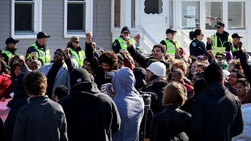 March 7, 2015: People gather during a rally protesting the shooting death of Tony Robinson.