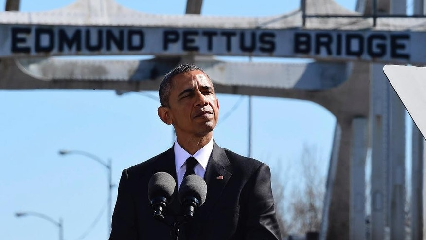 March 7, 2015: President Barack Obama speaks near the Edmund Pettus Bridge in Selma, Ala. (AP)