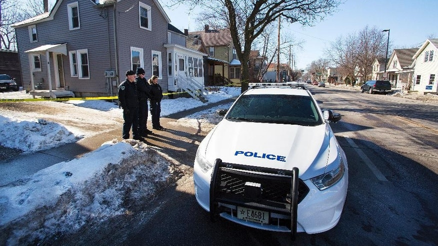 "Madison Police stand outside the scene of a police involved shooting at a home in Madison, Wis., on Saturday, March 7, 2015.  A 19-year-old black man died Friday night after being shot by a police officer in Madison, authorities said. The man was shot after an altercation with the officer and died at a hospital.  The officer did not know if the man was armed, but according to Police Chief Mike Koval, ""initial findings at the scene did not reflect a gun or anything of that nature that would have been used by the subject.  (AP Photo/Wisconsin State Journal, Steve Apps)"