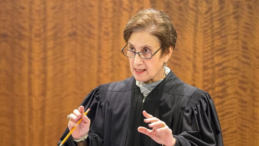 Judge Susan Garsh addresses the court during the murder trial of former New England Patriots tight end Aaron Hernandez Monday, March 9, 2015, at Bristol County Superior Court in Fall River, Ma. Hernandez is accused of the June 2013 killing of Odin Lloyd. (AP Photo/The Boston Globe, Aram Boghosian, Pool)