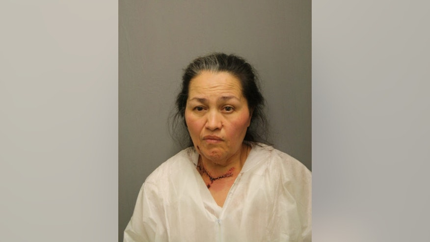 This image provided by the Chicago Police Department shows Manuela Rodriguez. The Chicago woman is charged in the death of her 7-month-old granddaughter, who was struck in the head multiple times before having her throat cut with a power saw, prosecutors announced Tuesday March 10, 2015. (AP Photo/Chicago Police Department)