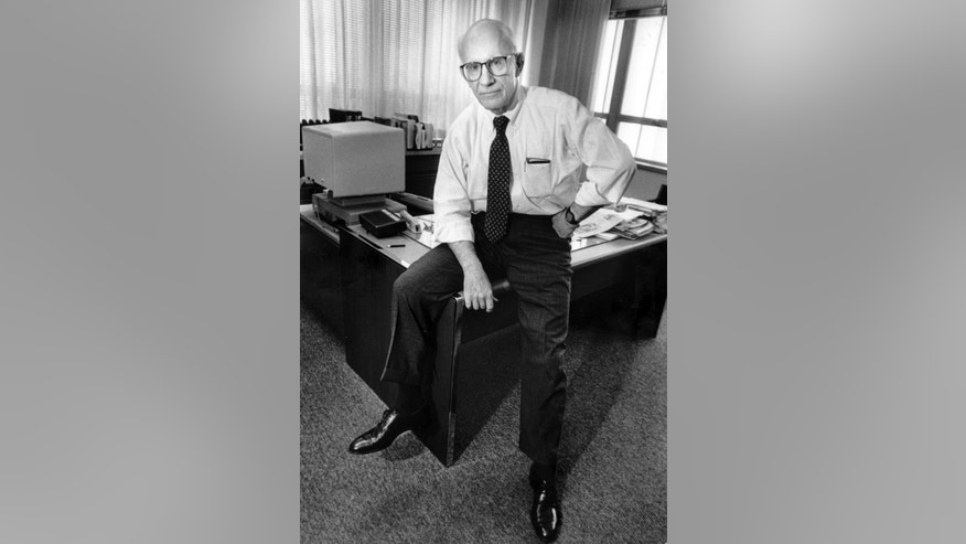 In this Oct. 16, 1990 photo, News & Observer editor Claude Sitton poses for a photo in his office, in Raleigh, N.C. Sitton, who was a leader among reporters covering the civil rights movement in the South in the 1950s and '60s and later won a Pulitzer Prize for distinguished commentary, died Tuesday, March 10, 2015. He was 89. (AP Photo/The News & Observer, Scott Sharpe)