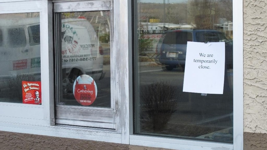 The drive-thru at a KFC restaurant in Reno remains closed Tuesday, March 10, 2015, the day after authorities say someone attempted a firebombing. The FBI is investigating after agents found a drive-thru window  broken, a flammable material inside and the initials of an animal rights group scrawled on an outside sign. (AP Photo/Scott Sonner)