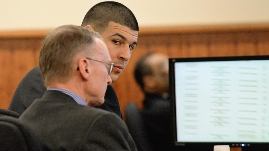Former New England Patriots football player Aaron Hernandez looks at defense attorney Charles Rankin during his trial at Bristol County Superior Court on Tuesday, March 10, 2015 in Fall River, Mass. Hernandez is accused of the June 2013 killing of Odin Lloyd. (AP Photo/Faith Ninivaggi, Pool)