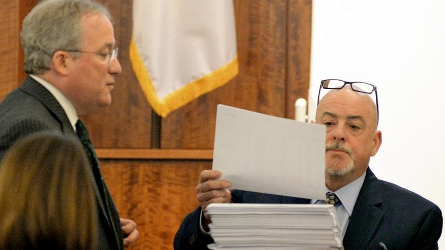 Prosecutor, Patrick Bomberg admits cell phone records as evidence to AT&T employee Christopher Ritchell during testimony of the trial of former New England Patriots football player Aaron Hernandez at Bristol County Superior Court on Tuesday, March 10, 2015 in Fall River, Mass. Hernandez is accused of the June 2013 killing of Odin Lloyd. (AP Photo/Faith Ninivaggi, Pool)