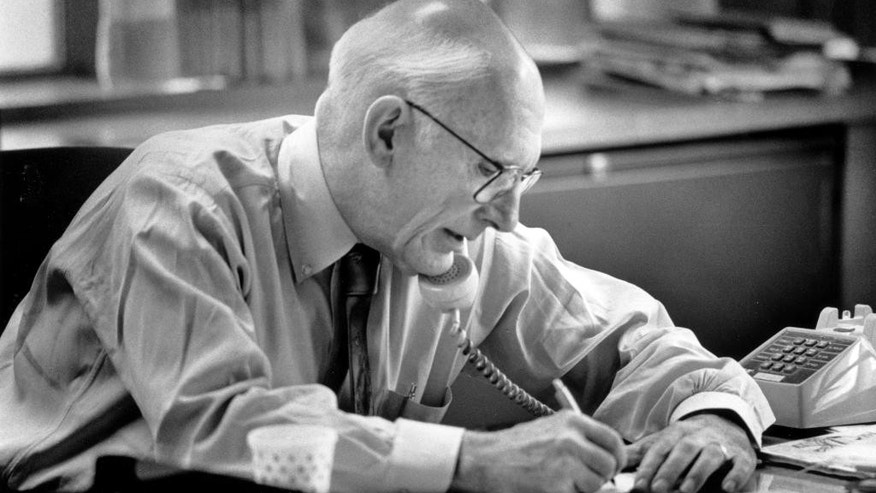 In this October 1990 photo, Claude Sitton, editor of The News & Observer, works in his office at the newspaper, in Raleigh, N.C. Sitton, who was a leader among reporters covering the civil rights movement in the South in the 1950s and '60s and later won a Pulitzer Prize for distinguished commentary, died Tuesday, March 10, 2015. He was 89. (AP Photo/The News & Observer, Harry Lynch)