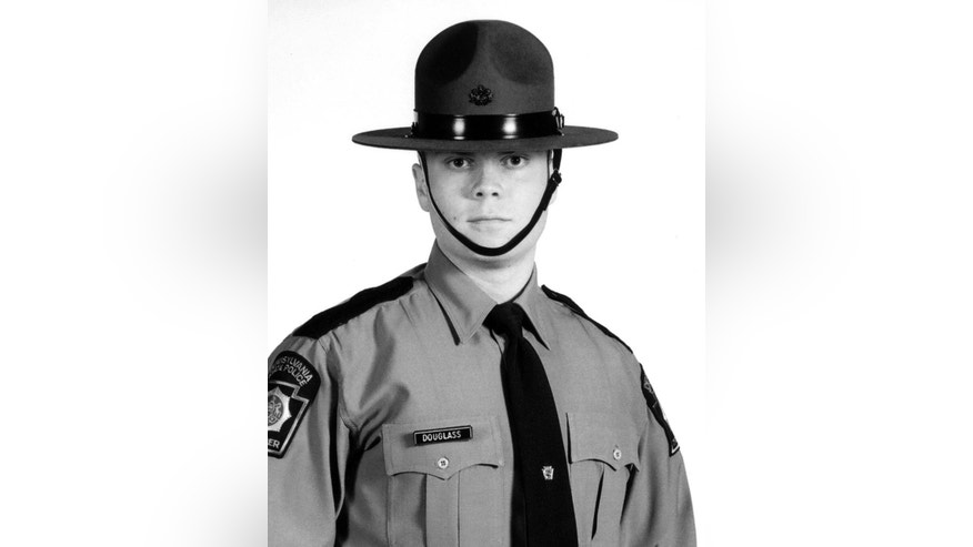 FILE - This undated file photo provided by the Pennsylvania State Police shows Trooper Alex Douglass. On Sept. 12, 2014, Douglass was wounded after a shooting ambush at the Pennsylvania State Police barracks in Blooming Grove Township, Pa., that also killed state Trooper Cpl. Bryon Dickson. Douglass, who had run a 50-mile ultra-marathon, is now learning to get around on an artificial hip. Six months after being shot, he has undergone 15 surgeries to repair the damage, and No. 16 is on the horizon. (AP Photo/Pennsylvania State Police, File)