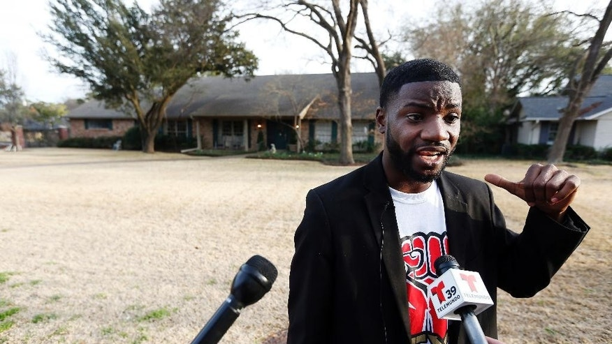 Next Generation Action Network President and Founder Dominique R. Alexander speaks to the media before leading a protest outside the family home of a former University of Oklahoma Sigma Alpha Epsilon fraternity member Parker Rice, Wednesday, March 11, 2015, in Dallas. Rice and several other fraternity members were seen on video chanting a racist song. (AP Photo/Brandon Wade)