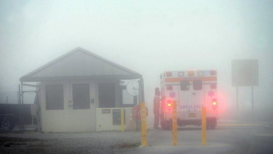 An Okaloosa County ambulance sits at the Eglin Air Force entrance in Fort Walton Beach, Fla., Wednesday, March 11, 2015.   Seven Marines and four soldiers aboard an Army helicopter that crashed over waters off Florida during a routine night training mission were presumed dead Wednesday, and crews found human remains despite heavy fog hampering search efforts, military officials said. (AP Photo/Northwest Daily News, Devon Ravine)