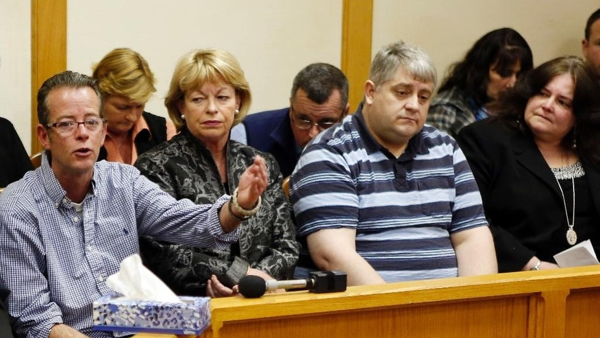 "Dean Smart, far left, speaks Thursday, March 12, 2015, during a parole hearing at the state prison in Concord, N.H. for William ""Billy"" Flynn, who shot and killed his brother nearly 25 years ago. Flynn was 16 in 1990 when he and three friends carried out what prosecutors said was Pamela Smart's plot to murder her husband, Gregg Smart. (AP Photo/Jim Cole)"