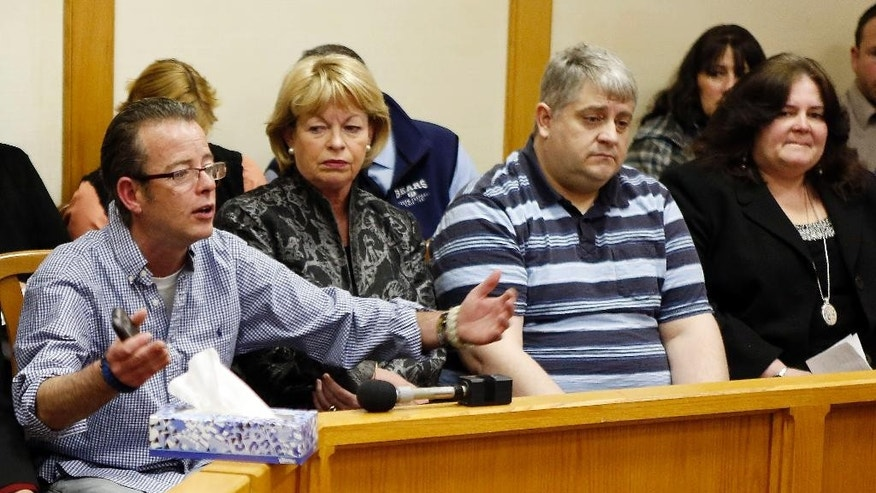 "Dean Smart, far left, speaks Thursday March 12, 2015, during a parole hearing at the state prison in Concord, N.H. for William ""Billy"" Flynn who shot and killed his brother nearly 25 years ago.  Flynn was 16 in 1990 when he and three friends carried out what prosecutors said was Pamela Smart's plot to murder her husband Gregg Smart. (AP Photo/Jim Cole)"