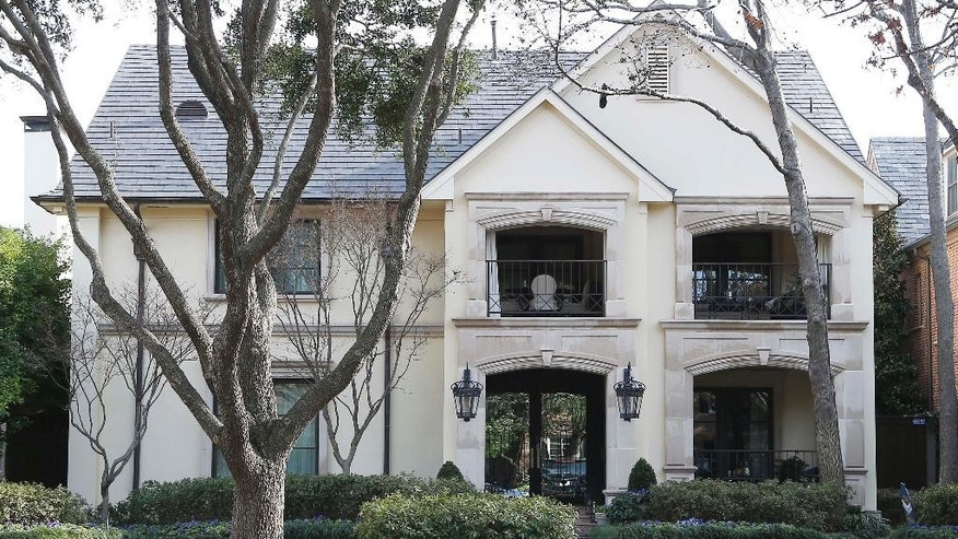 This photo shows the family home of former University of Oklahoma Sigma Alpha Epsilon fraternity member Levi Pettit, Wednesday, March 11, 2015, in Dallas. Two students have been expelled from the university following an incident in which members of a fraternity were caught on video chanting a racial slur. (AP Photo/Brandon Wade)