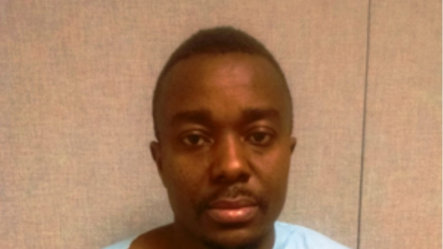 This image provided by the Montgomery County Police Department shows Roland Zinneh of Darby, Pa. Police in Maryland have charged Zinneh in the death of a Germantown pastor asked to pray over him to help stop voices he was hearing. Montgomery County Police said in a statement Friday, March 13, that Zinneh is charged with first-degree murder in the death of 57-year-old Connery Dagadu. (AP Photo/Montogomery County Police Department)