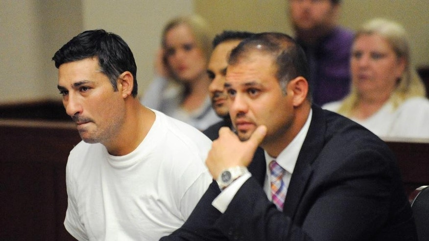 Bassel Abdul Saad, left, sitting with his attorney Ali Hammoud, faces sentencing Friday in one-punch killing of referee John Bieniewicz during a game.(AP Photo/Detroit News, David Coates)