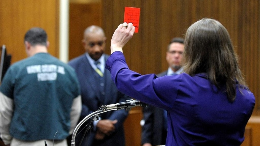 "Jon Bieniewicz's widow, Kris Bieniewicz, addresses the court as she gives the last victim's impact statement and holds up a soccer ""red flag' in the courtroom of Wayne County Circuit Court Judge Thomas Cameron on Friday, March 13, 2015 in Detroit.  Bassel Saad  was sentenced to at least eight years in prison for a punch that killed  Bieniewicz, a Detroit-area referee.  (AP Photo/Detroit News, Todd McInturf)  DETROIT FREE PRESS OUT; HUFFINGTON POST OUT"