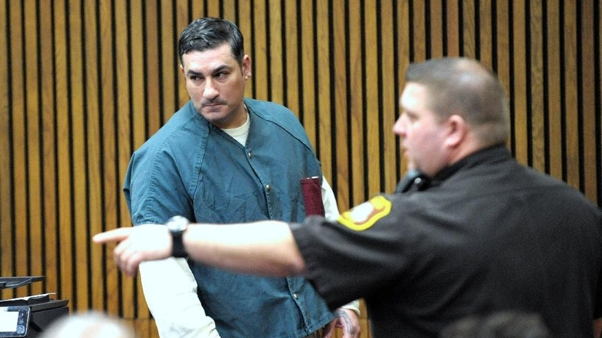 A Wayne County deputy directs Bassel Saad, left, into the courtroom of Wayne County Circuit Court Judge Thomas Cameron on Friday, March 13, 2015 in Detroit.  Saad  was sentenced to at least eight years in prison for a punch that killed John Bieniewicz, a Detroit-area referee.  (AP Photo/Detroit News, Todd McInturf)  DETROIT FREE PRESS OUT; HUFFINGTON POST OUT