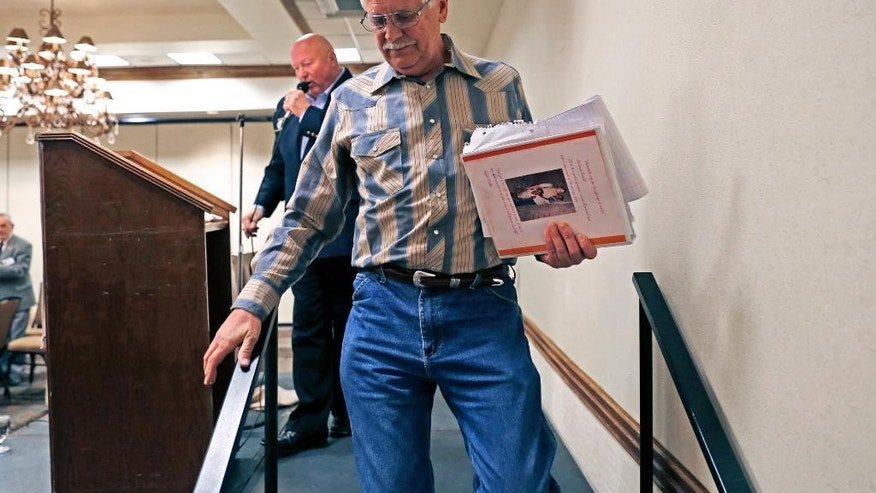 Carl Mueller, of Prescott, Ariz., walks off stage after giving a speech about his daughter who was killed by ISIS, Saturday, March 14, 2015, during the mid-year conference for the Southwestern District of the Kiwanis International at Mariott in Farmington, N.M. (AP Photo/The Daily Times, Alexa Rogals)