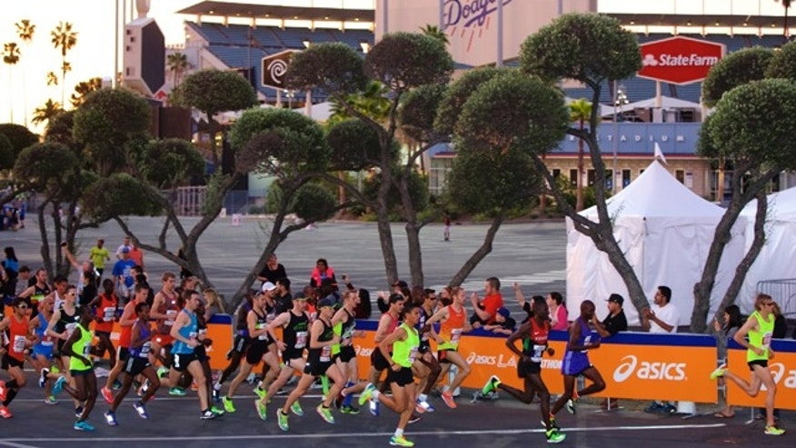 March 15, 2015: Men's elite runners start the 30th Los Angeles Marathon. The 26.2-mile event begins at Dodger Stadium and ends in Santa Monica, Calif. (AP Photo/Damian Dovarganes)