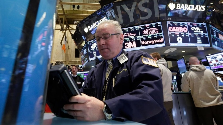 Trader James Dresch works on the floor of the New York Stock Exchange, Monday, March 16, 2015. U.S. stocks opened higher, led by health care and utilities companies, rebounding after three weeks of losses. (AP Photo/Richard Drew)