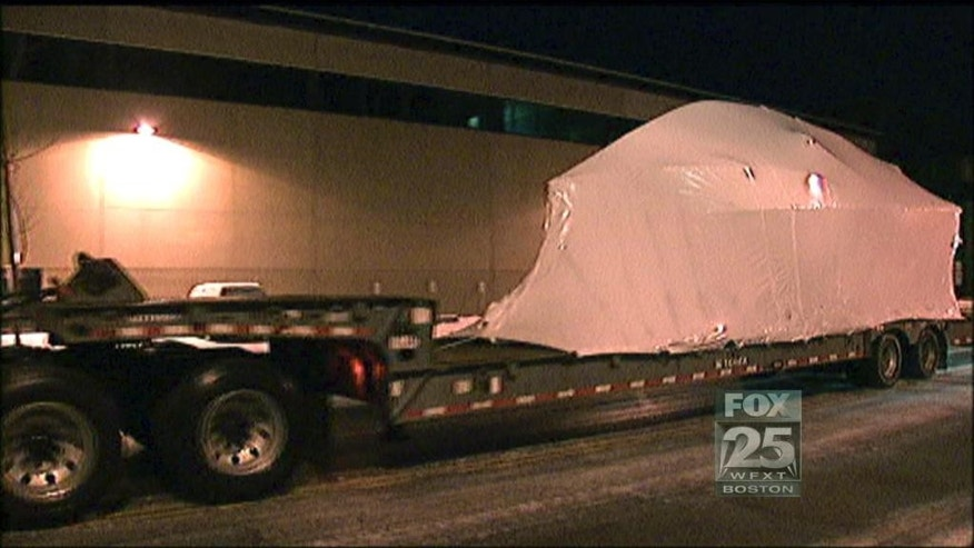 This still image from video provided by Fox25 Television in Boston shows the covered boat in which Dzhokhar Tsarnaev was captured, being transported along a street in Boston, early Monday, March 16, 2015, for viewing by jurors during the morning session of Tsarnaev's federal death penalty trial. Tsarnaev is charged with conspiring with his brother to place two bombs near the Boston Marathon finish line that killed three and injured more than 260 people in April 2013. He was captured in the bullet-riddled boat in a Watertown, Mass., backyard. Inside the boat, called the Slipaway II, Tsarnaev wrote a note in pencil and stained with long streaks of blood, in which he denounced the U.S., for its wars in Muslim countries.  (AP Photo/Fox25 Television) MANDATORY CREDIT