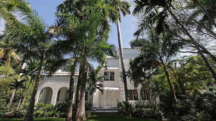 The main entrance to the historic waterfront mansion once owned by gangster Al Capone is shown, in Miami Beach, Fla., Wednesday, March 18, 2015. The mansion, which had fallen into a state of disrepair, is being restored to its Prohibition-era opulence and beginning what the property's new managers said Wednesday is a new chapter as a sun-splashed site for video and photo shoots. (AP Photo/Alan Diaz)