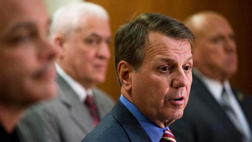 Burlington County Prosecutor Robert Bernardi, center right, speaks during a news conference, Wednesday, March 18, 2015, in Mount Holly, N.J. Bernardi announced Wednesday that the body of 26-year-old Erica Crippen was found Tuesday afternoon in Sykesville, Md. Bernardi is accompanied by from the left, Mount Laurel Police Chief Dennis Cribben, Deputy First Assistant Prosecutor James Ronca, and chief investigator Frederick D'Ascentis, right. Crippen's husband, 28-year-old Kyle Crosby, is charged with her murder.  (AP Photo/Matt Rourke)