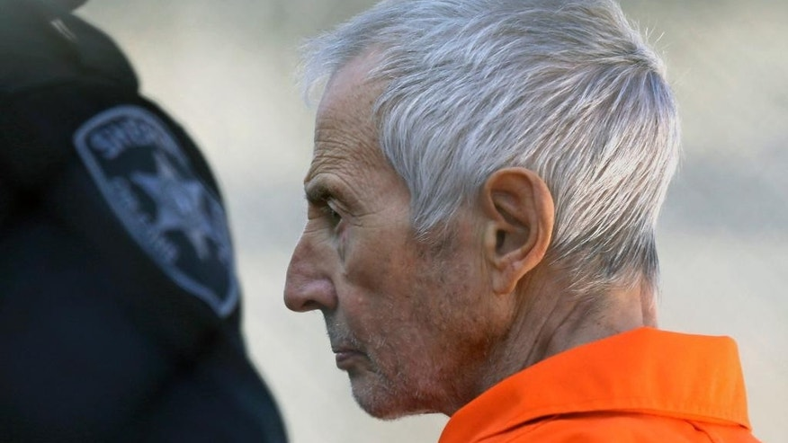 FILE - In this Tuesday, March 17, 2015, file photo, Robert Durst is escorted into Orleans Parish Prison after his arraignment in Orleans Parish Criminal District Court in New Orleans. The whispered words of Durst recorded in an unguarded moment in a bathroom could come back to haunt him - or help him - as he faces a murder charge. A possible move by prosecutors to introduce the incriminating material from a six-part documentary on his strange life and connection to three killings could back fire as interview footage did in the Michael Jackson molestation trial and the Robert Blake murder case.  (AP Photo/Gerald Herbert, File)