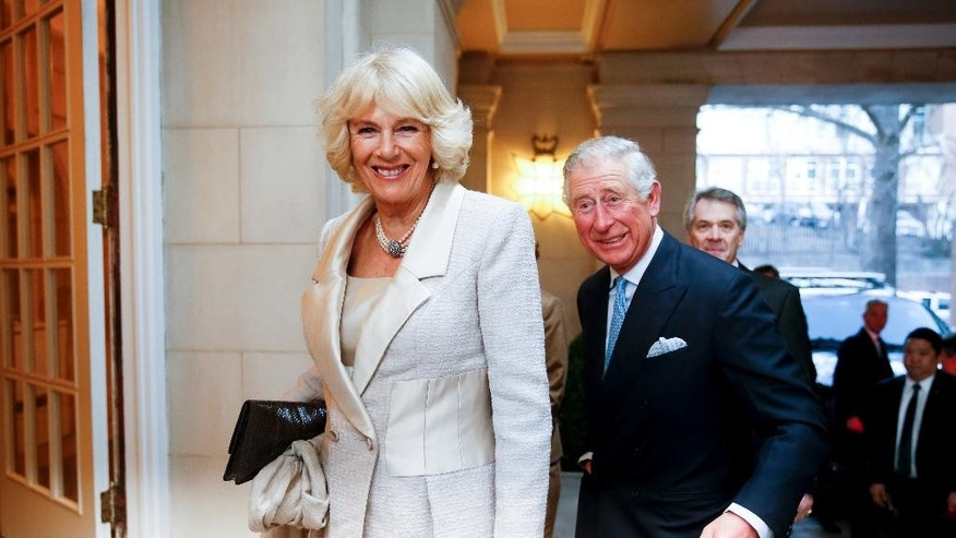 Britain's Prince Charles and Camilla, the Duchess of Cornwall arrive for a reception at the British Ambassador's residence on Tuesday, March 17, 2015, in Washington. The royal couple will visit cultural and educational sites in the Washington region over the next three days. (AP Photo/Andrew Harnik)