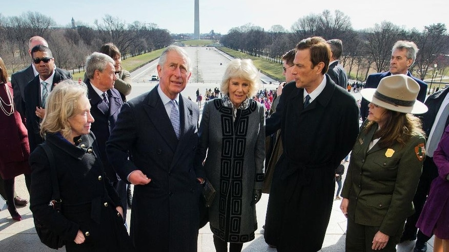 Britain's Prince Charles with Camilla, the Duchess of Cornwall, center, stand on the spot that Rev. Martin Luther King gave his 'I have a Dream' speech during his tour of the Lincoln Memorial on the National Mall during their visit to Washington, Wednesday, March 18, 2015. With them are from left to right, Doris Kearns Goodwin,  Pulitzer Prize-winning American biographer, historian, and political commentator, Michael Richard Beschloss an American historian, and Karen Cucurullo, left, of the National Park Service. (AP Photo/Pablo Martinez Monsivais)
