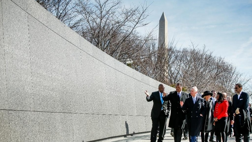 Britain's Prince Charles, third from left, and Camilla, the Duchess of Cornwall, third from right, tour the Martin Luther King, Jr. Memorial with President and CEO of the Martin Luther King, Jr. Memorial Project Foundation Harry Johnson, left, Rev. Jesse Jackson, second from left, Rep. Terri Sewell, D-Ala., second from right, and Dr. Ed Jackson, chief architect of the memorial, right, Wednesday, March 18, 2015 in Washington. The royal couple are visiting cultural and educational sites in the Washington region. (AP Photo/Andrew Harnik)
