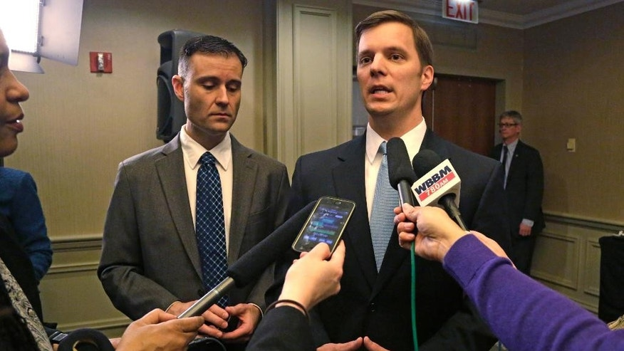 Sigma Alpha Epsilon Fraternity Executive Director Blane Ayers, right, and spokesperson Brandon Weghorst speak to reporters after a news conference Wednesday, March 18, 2015, in Chicago. The college fraternity that has been under scrutiny since members of its University of Oklahoma chapter were caught on video engaging in a racist chant says it will require all of its members, nationwide, to go through diversity training. Ayers said that he was disgusted by the video that surfaced last week. He apologized for the pain it caused and outlined steps meant to ensure it never happens again. (AP Photo/M. Spencer Green)