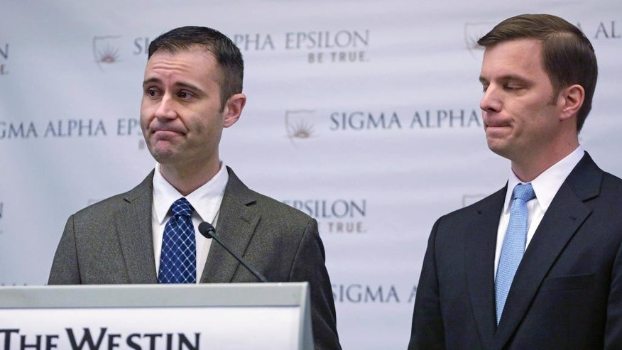 Sigma Alpha Epsilon Fraternity Executive Director Blane Ayers, right, and spokesperson Brandon Weghorst take questions from reporters after a news conference Wednesday, March 18, 2015, in Chicago. The college fraternity that has been under scrutiny since members of its University of Oklahoma chapter were caught on video engaging in a racist chant says it will require all of its members, nationwide, to go through diversity training. Ayers that he was disgusted by the video that surfaced last week. He apologized for the pain it caused and outlined steps meant to ensure it never happens again. (AP Photo/M. Spencer Green)