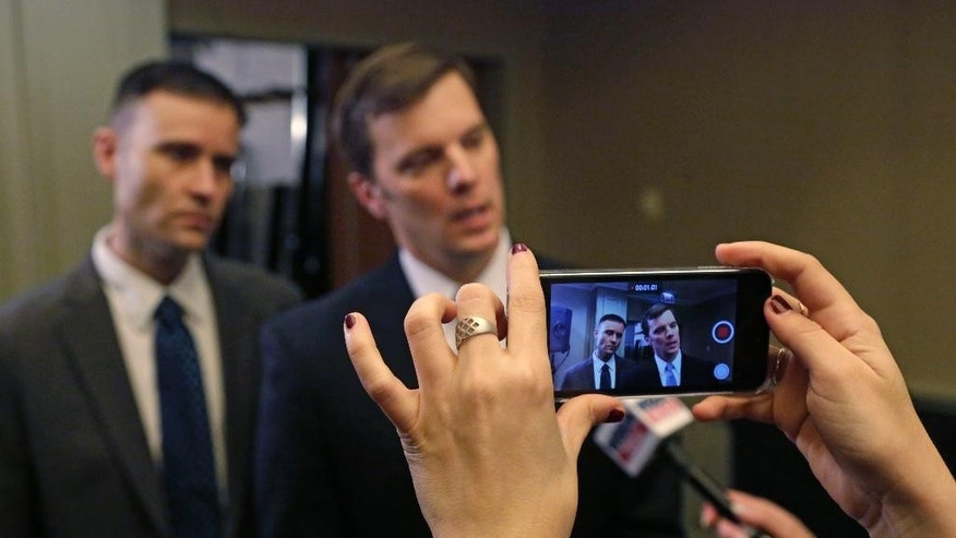 Sigma Alpha Epsilon Fraternity Executive Director Blane Ayers, right, and spokesperson Brandon Weghorst are video recorded as they speak to reporters after a news conference Wednesday, March 18, 2015, in Chicago. The college fraternity that has been under scrutiny since members of its University of Oklahoma chapter were caught on video engaging in a racist chant says it will require all of its members, nationwide, to go through diversity training. Ayers that he was disgusted by the video that surfaced last week. He apologized for the pain it caused and outlined steps meant to ensure it never happens again. (AP Photo/M. Spencer Green)
