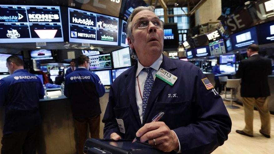 Trader Thomas Kay works on the floor of the New York Stock Exchange, Wednesday, March 18, 2015. Stocks are falling for the second day in a row as traders try to guess when U.S. interest rates will rise. (AP Photo/Richard Drew)