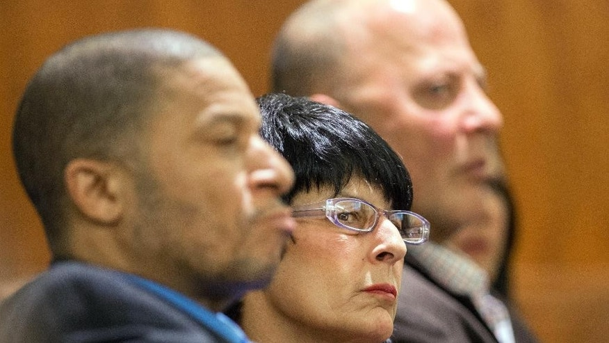Terri Hernandez, right listens during the trial of her son, former New England Patriots football player Aaron Hernandez  on Tuesday, March 17, 2015, in Fall River, Mass. Hernandez is charged with killing semiprofessional football player Odin Lloyd. (AP Photo/The Boston Herald, Ted Fitzgerald, Pool)