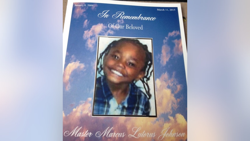 This image provided by Marcus Johnson Sr. shows Marcus Johnson Jr.'s funeral pamphlet. Marcus Johnson Jr.'s parents figured a sunny day at a city park was just what the 6-year-old kindergartner needed while recovering from heart surgery the previous week and a doctor's visit that same day. Instead, his family will bury Marcus on Thursday, March 19, 2015, after the child was shot in the chest and killed in an attack his mother and father said stemmed from a traffic dispute. (AP Photo/Marcus Johnson Sr.)