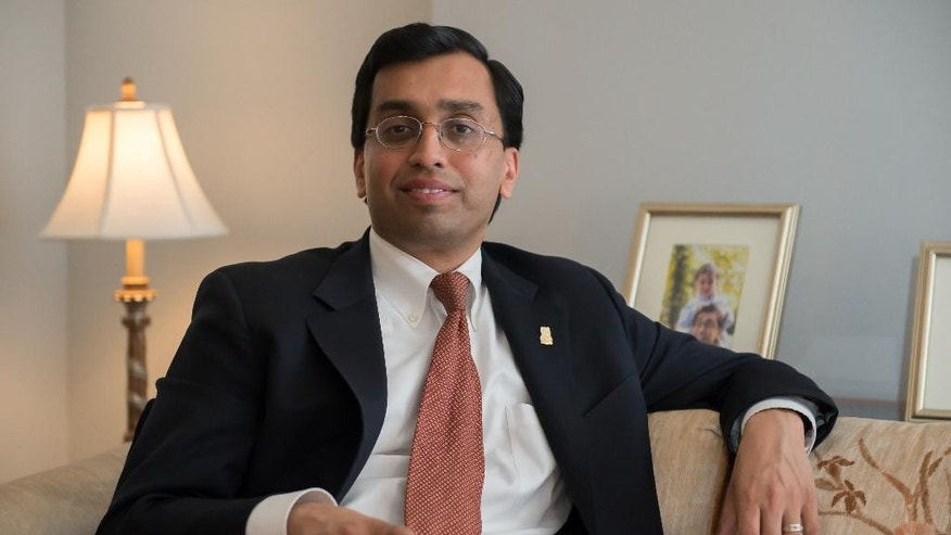 In this March 17, 2015, photo, former National Security Agency general counsel Raj De poses for a photo in his home in Chevy Chase, Md. The Harvard-trained lawyer departed last week as NSA gneral counsel following stints at the White House, the Justice Department and the 9/11 Commission. (AP Photo/Molly Riley)